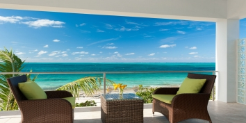 The master bedroom patio of Sea Edge Villa with stunning views of Grace Bay Beach, Turks and Caicos Islands.