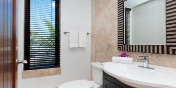 This Providenciales vacation villa rental has a separate powder room.