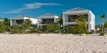 You can quite literally walk for miles along the soft, sandy beach from The Villas at Grace Bay, Turks and Caicos Islands.