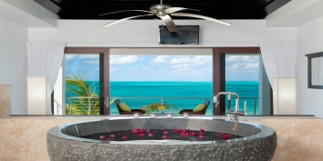 This beautiful and romantic one bedroom beach villa has a stunning master bedroom suite with views of Grace Bay Beach.