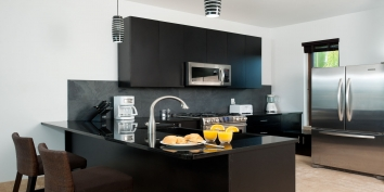 The kitchen of Water Edge Villa is fully equipped for your vacation in the Turks and Caicos Islands.