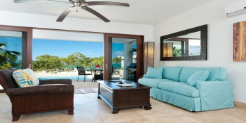 Water Edge Villa features luxurious interiors across two levels of living space, multiple terraces and breathtaking views of Grace Bay Beach and Turtle Cover Marina.