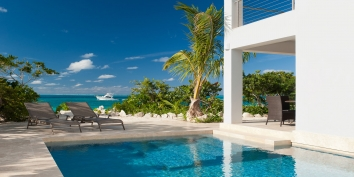 Dip your feet into your private, freshwater swimming pool at Water Edge Villa, Grace Bay Beach, Providenciales (Provo), Turks and Caicos Islands.