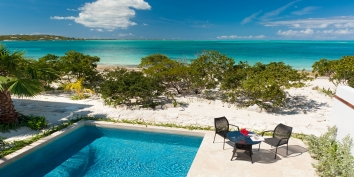 From the upper level balcony you have fantastic views of Grace Bay Beach at this Turks and Caicos vacation villa rental.