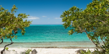The turquoise sea of Grace Bay is right in front of Water Edge Villa, Grace Bay Beach, Providenciales (Provo), Turks and Caicos Islands.