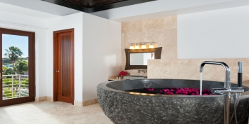 Water Edge Villa, Grace Bay Beach, Providenciales (Provo), Turks and Caicos Islands has a large, granite bathtub.