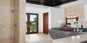 The beautifully designed bathroom of Water Edge Villa has an impressive, large granite bathtub.