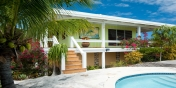 Reef Beach House is charming island-style beach house with its own very private fresh water swimming pool.