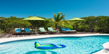 Reef Beach House has a very private swimming pool surrounded by lush tropical landscaping.