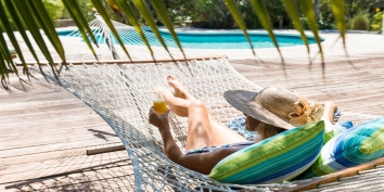 Take a break in the cosy hammock at Reef Beach House, Grace Bay Beach, Providenciales, Turks and Caicos Islands.