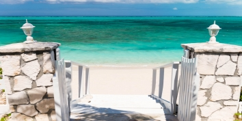 The  beautiful turquoise sea of Grace Bay Beach is just steps away from Reef Beach House, Providenciales villa rental.