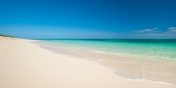 The beautiful, soft, white beach and crystal clear sea right in front of Reef Beach House, Grace Bay Beach, Providenciales (Provo), Turks and Caicos Islands.