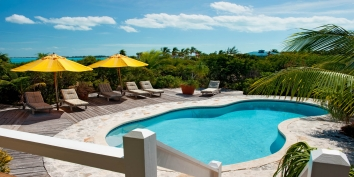 Coll off in the pool or relax on the spacious pool deck at this Providenciales holiday villa rental.