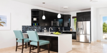 The modern and fully equipped kitchen of Miami Vice One, Sapodilla Bay, Turks and Caicos Islands.