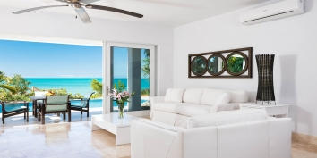 The open-concept living room of Miami Vice One, Sapodilla Bay, Provo, Turks and Caicos Islands.
