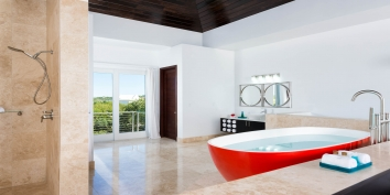 Soak in the luxurious tub while watching the sunset over Sapodilla Bay at this Turks and Caicos vacation villa rental.