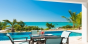 Prepare a romantic dinner by the extra large swimming pool at this Providenciales holiday villa rental.
