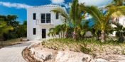 This Turks and Caicos villa rental features a gated driveway entrance.