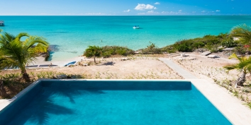 The large, diminishing-edge swimming pool at Miami Vice Two, Sapodilla Bay, Providenciales (Provo), Turks and Caicos Islands.