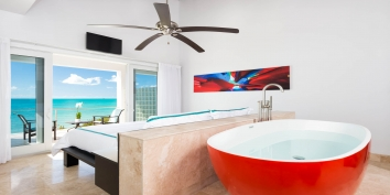 This Turks and Caicos oceanfront villa rental has two equal open-concept master bedroom suites with large bathtubs for your relaxation.