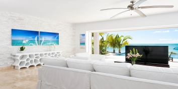 The 65 flat-screen TV rises smoothly out of the living room floor at Miami Vice Two, Sapodilla Bay, Providenciales (Provo), Turks and Caicos Islands.