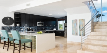 This Turks and Caicos luxury oceanfront villa rental has a modern kitchen equipped with everything you may need while on vacation.