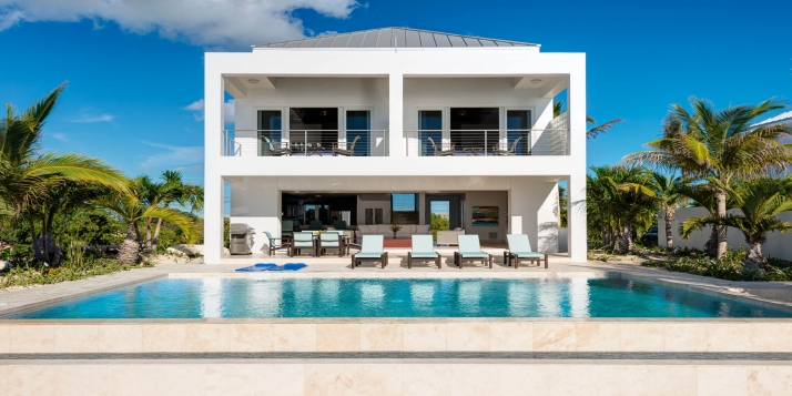 A contemporary, luxury, oceanfront villa with two equal master bedroom suites, large diminishing-edge swimming pool and stunning views of the crystal clear sea!