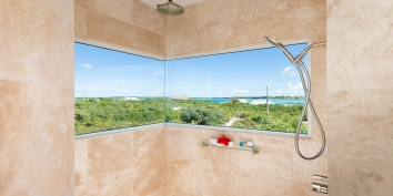 Take a refreshing shower while overlooking the magnificent landscape of Providenciales, Turks and Caicos Islands.