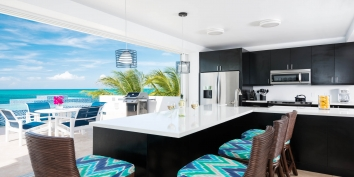 This Turks and Caicos beach villa rental has a modern kitchen equipped with everything you may need while on vacation.