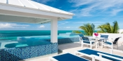 The swimming pool and terrace of Plum Wild beach villa, Grace Bay Beach, Providenciales (Provo), Turks and Caicos Islands.