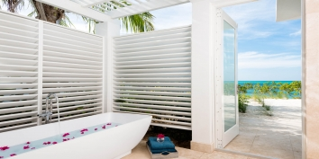One of the wonderful outdoor bathrooms of this Turks and Caicos beach villa rental.