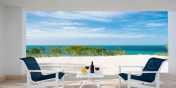 Each of the master bedroom suites of this Turks and Caicos vacation villa rental has a private patio.