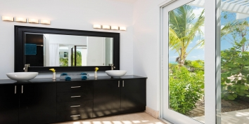 One of the beautiful indoor bathrooms of this Turks and Caicos beach villa rental.