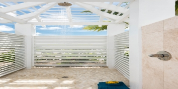 Bothe master bedroom suites have indoor and outdoor bathrooms atPlum Wild, Grace Bay Beach, Providenciales (Provo), Turks and Caicos Islands.