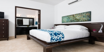 A tastefully decorated and spacious master bedroom at Plum Wild, Grace Bay Beach, Providenciales (Provo), Turks and Caicos Islands.