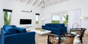 The light and spacious living room of Plum Wild, Grace Bay Beach, Providenciales (Provo), Turks and Caicos Islands.