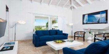 This Turks and Caicos beach villa rental has an open concept kitchen and living room with great views of Grace Bay.
