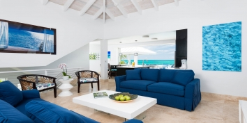 This Turks and Caicos beach villa rental has a large, flatscreen TV in the spacious living room.