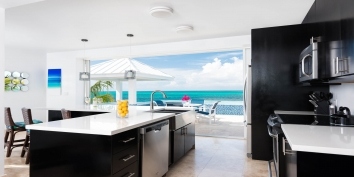 The modern and fully equipped kitchen of Plum Wild, Grace Bay Beach, Providenciales (Provo), Turks and Caicos Islands.