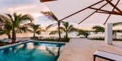 This Turks and Caicos beach villa rental offers gorgeous views from the swimming pool terrace.