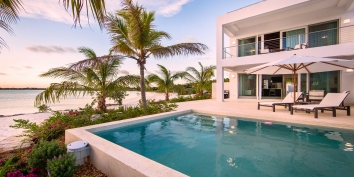 This Turks and Caicos beach villa rental is perfectly located on beautiful and tranquil Sapodilla Bay Beach.