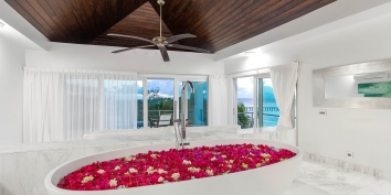 You can relax in the bathtub and still enjoy the views from this Turks and Caicos beach villa rental.