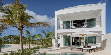 An intimate, one bedroom, beachfront vacation rental with private swimming pool and gorgeous views of the turquoise sea!