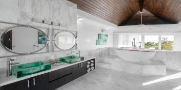 The bathroom features double vanity sinks and bathtub at Villa Positano, Sapodilla Bay Beach, Providenciales (Provo), Turks and Caicos Islands.