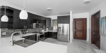 This Turks and Caicos beach villa rental has a modern kitchen equipped with everything you may need during your vacation.