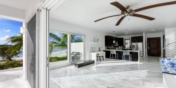 The open concept living room and kitchen at Villa Positano, Sapodilla Bay Beach, Providenciales (Provo), Turks and Caicos Islands.
