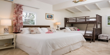 A family bedroom in this Turks and Caicos villa rental.