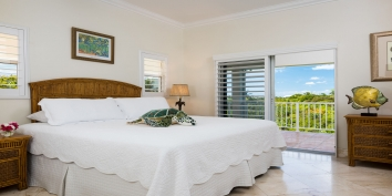 A comfortable bedroom at Reef Pearl, Grace Bay Beach, Providenciales (Provo), Turks and Caicos Islands.