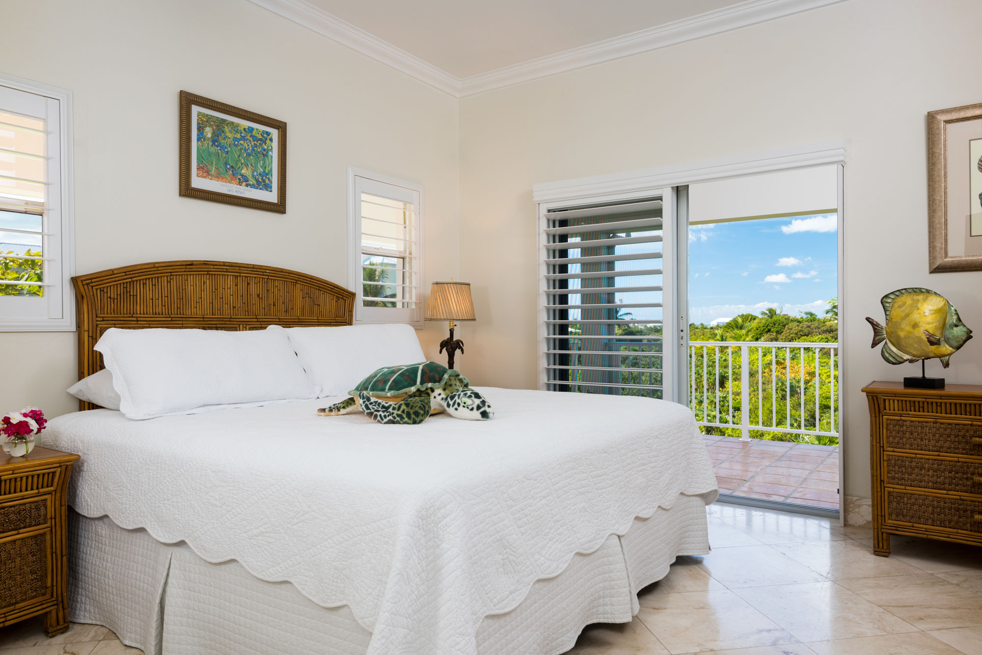 An upper level bedroom with queen-size bed at Reef Pearl, Grace Bay Beach, Providenciales (Provo), Turks and Caicos Islands.