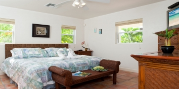A comfortable bedroom in this Grace Bay villa rental.